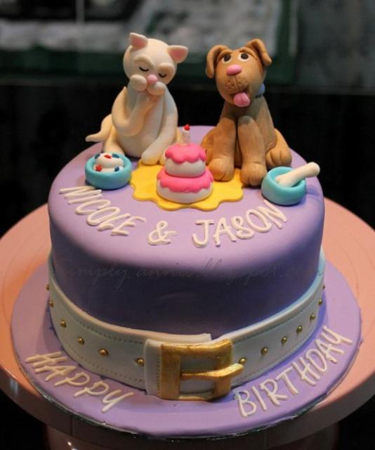 Photograph of Dog + Cat theme birthday cake for twins