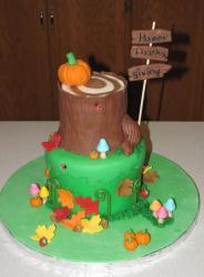 2 tier Thanksgiving cake with pumpkin and fall foliage.JPG