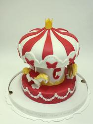 Merry-Go-Round Carousal cake with ponies in red and white.JPG