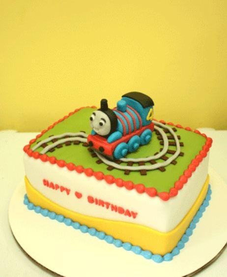 Rectangular Thomas the Train birthday cake with tracks.JPG