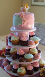 Baptism cupcakes with big cake on the top.PNG