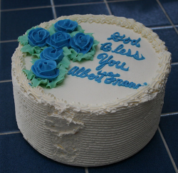 Simple baptism cake for boy with blue floral cross shape cake decor with letters.PNG