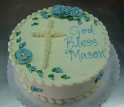 Simple round baptism cakes for boys with cross cake decor and flowers.PNG