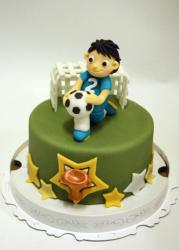 Soccer theme green cake with player, goal, ball and trophy.JPG