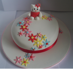 Modern Hello Kitty cake with flowers.PNG
