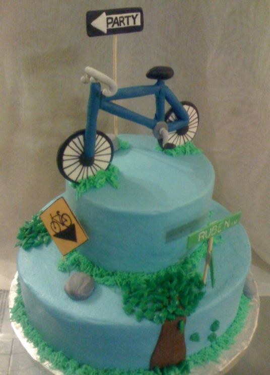2 tier blue round biking theme cake.JPG