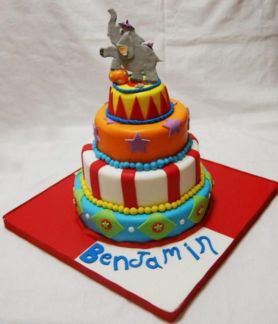 Four tier circus theme birthday cake with performing elephant on top.JPG
