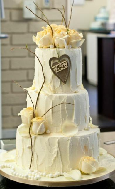 Triple Tier Round White Cream Wedding Cake With White Roses On Top And Chocolate HeartJPG