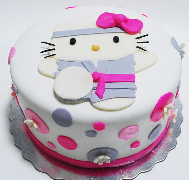 Cute karate hello kitty cakes with grey and bright pink cake decors ...