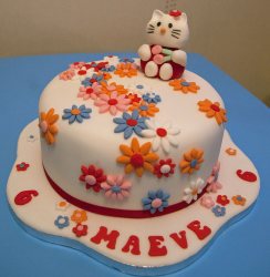 Floral Hello Kitty Cakes with Hello Kitty cake topper.PNG