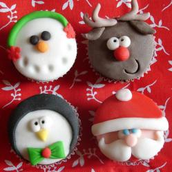 Christmas theme cupcakes in Snowman, Reindeer, Penguin and Santa face.JPG