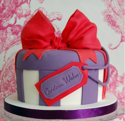 Stylish Christmas cake with a gift box shape.PNG