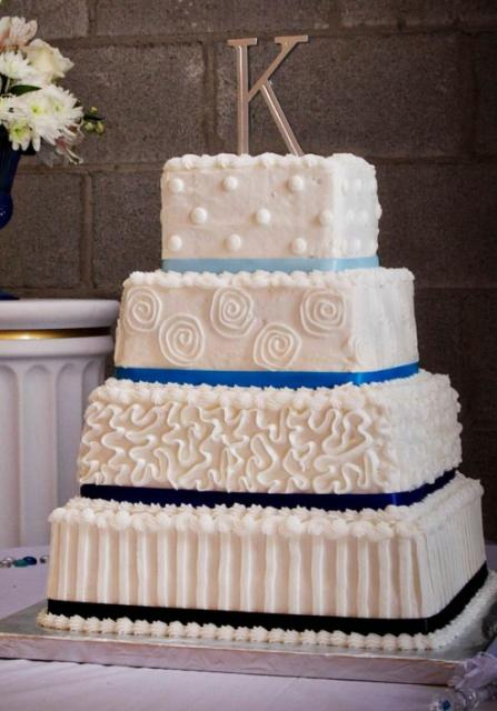 Four Tier Square White Wedding Cake With Large Monogram