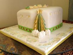 Christmas cake in white with tree and penguins and ornaments.JPG