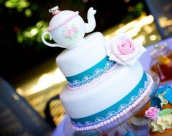 Three tier cake with tea kettle on top and pink roses.JPG
