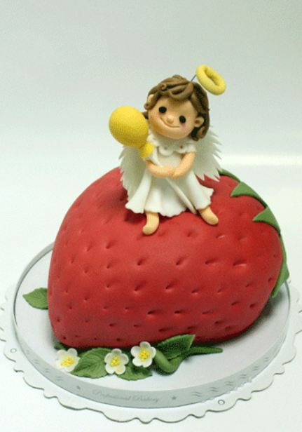 Cake In The Shape Of A Strawberry With An Angel On Top Jpg