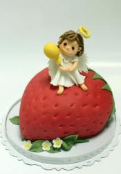 Cake in the shape of a strawberry with an angel on top.JPG