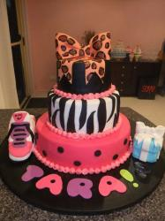 3 tier birthday cake for girl with zebra stripes, Nike shoes, gift box and bow on top.JPG