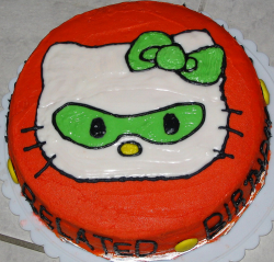 Green masked hello kitty cake in bright red and round shape.PNG