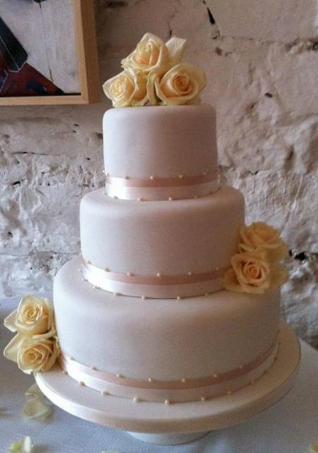 3 Tier Light Pink Round Wedding Cake With Yellow RosesJPG