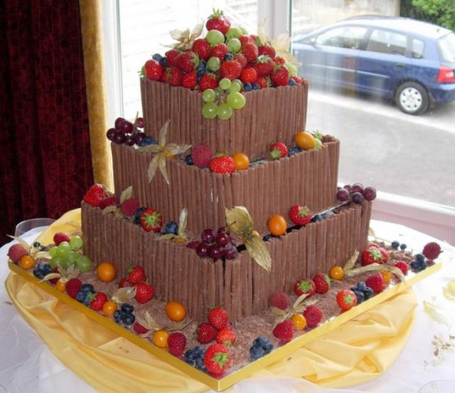 3 tier square chocolate cake with chocolate sticks and fresh fruits.JPG