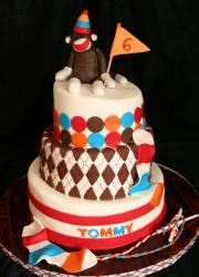 3 tier 6th birthday cake with monkey on top.JPG