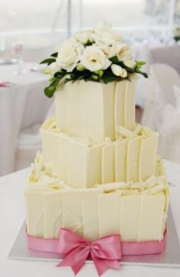 chocolate wedding cake with pink flowers 3 tier white chocolate wedding cake with white roses on 12811