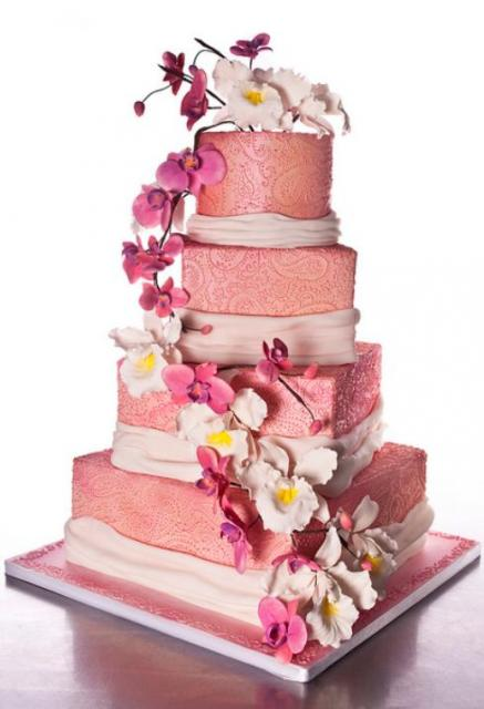 Pink 4 tier wedding cake with white and pink flowers.JPG