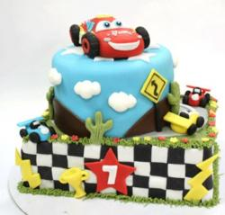 2 tier Cars cake with Lightning McQueen on top.JPG
