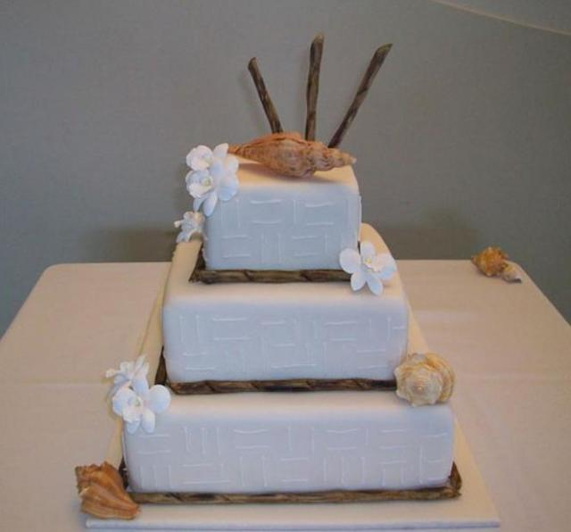 3 tier white square wedding cake with conch shells.JPG