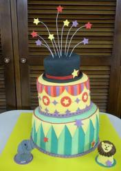 Tri-tier circus theme birthday cake with stars and stripes and lion and elephant.JPG