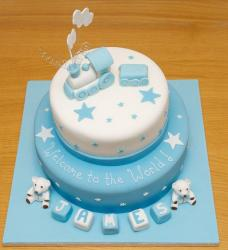 Two tier baby shower cake for boy with train and baby blocks.JPG