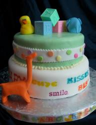 2 tier round baby shower cake with baby blocks, rubber ducky and dinosaur.JPG
