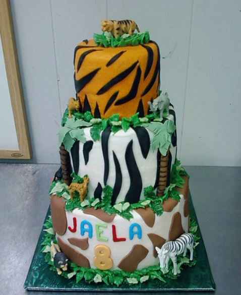 3 tier safari theme birthday cake with animal stripes and spots on each tier.JPG