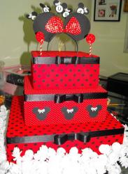 Three tier red birthday cake with black pokadots and minnie mouse patterns.JPG
