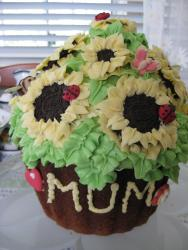 Spring theme cupcake with flowers and ladybugs.JPG