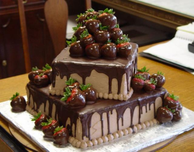 2 tier square chocolate cake with chocolate dipped strawberries.JPG
