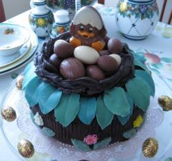 Chocolate cake with chocolate eggs in a nest on top.JPG