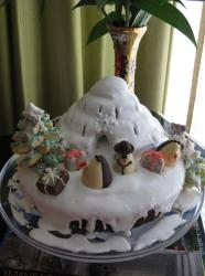 Christmas theme cake with igloo and snowman and cookie tree.JPG
