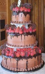 3 tier chocolate round wedding cake with fresh strawberries.JPG