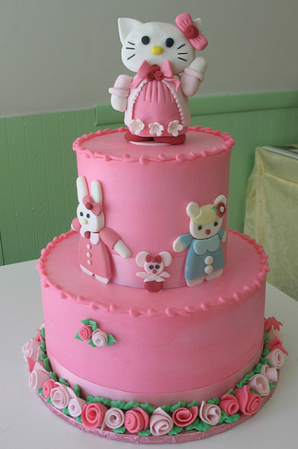 Three pink tiers Hello Kitty cakes with hello kitty cake toppers.PNG