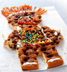 Cool looking kids danish cake with full of colorful candy and spiky candy orange hair.PNG