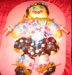 Danish  cake girl with cake decor with m & m candy and chocolate with long string candy.PNG