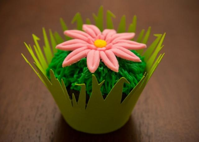 Floral theme chocolate cupcake with pink flower on top.JPG