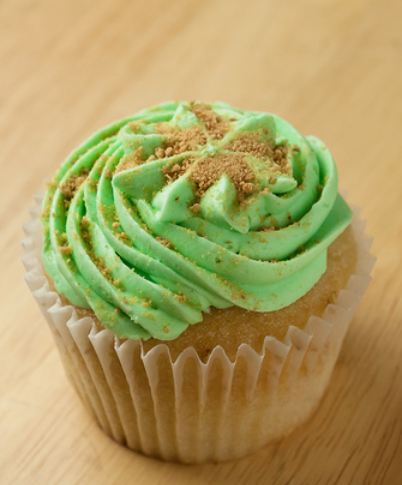 Cupcake with green cream topping and brown sugar.JPG