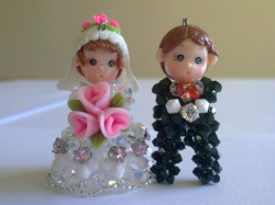 Unique wedding cake topper looking so cute and pretty.PNG