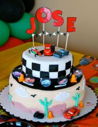 2 tier Cars cake with desert landscape on first tier.JPG