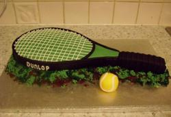 Dunlop tennis racquet cake with ball.JPG
