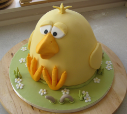 Gaint Easter cake with large chick and a worm on the side.PNG