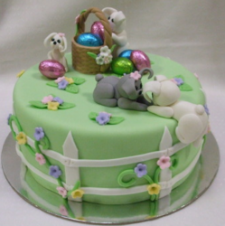 Green easter cake with dogs going on easter hunt.PNG
